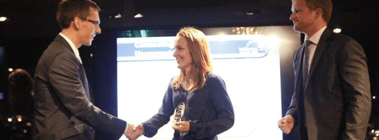 Elaine Weidman-Grunewald, receiving Ericsson's Telecom.com Award for the firm's Millennium Villages project