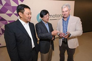From left to right: Lenovo's Liu Jun and Yang Yuanqing with Rick Osterloh from Motorola