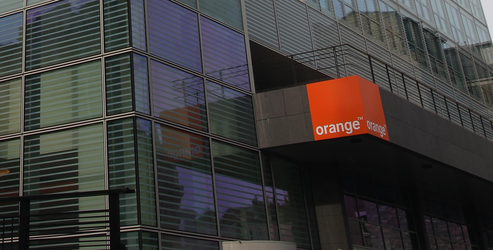 Orange logo on building