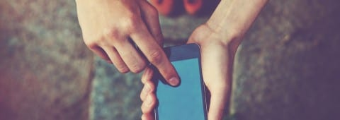 hands using a phone texting on smartphone app messaging LTE