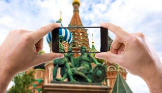 Hand holding Smartphone in Moscow, Russia