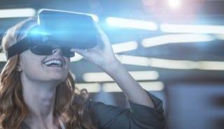 Smiling businesswoman using virtual reality simulator