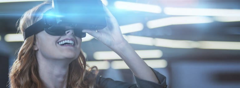 Smiling businesswoman using virtual reality simulator