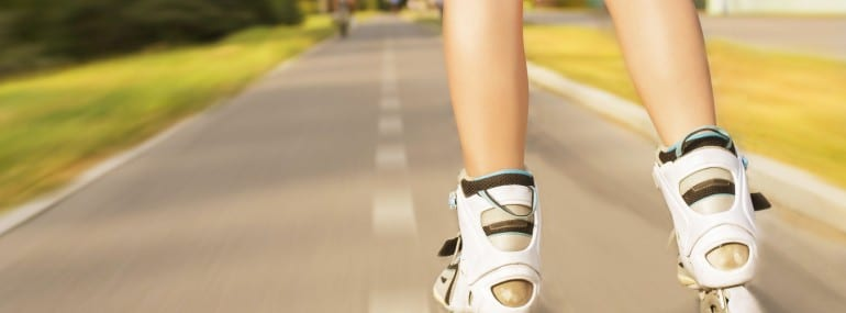 Beautiful girl with roller blade in park, motion blur effect. Outdoor, recreation, lifestyle, rollerblading.