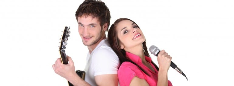 Young couple singing and playing guitar