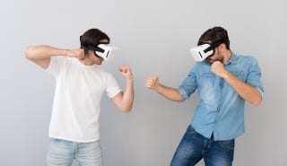 Serious men using virtual reality glasses