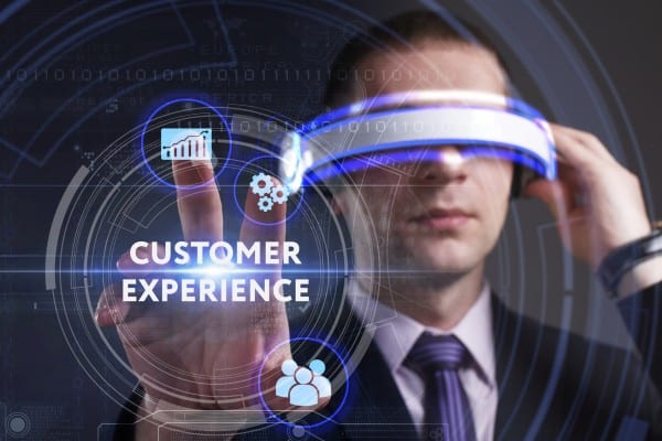 Business, Technology, Internet and network concept. Young businessman working in virtual reality glasses sees the inscription: Customer experience