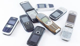 Old mobile cell phones isolated concept