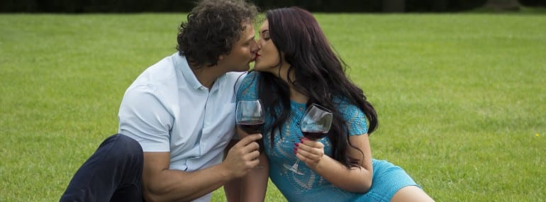 Young loving couple drinking wine outdoor. Romantic and love