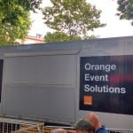 One of the three Orange buses in the technical area