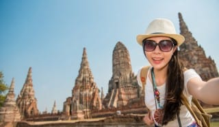 Happy tourist taking camera picture selfie
