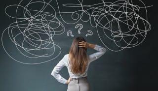 Businesswoman Mess on Blackboard