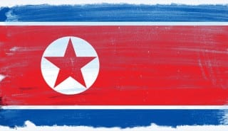 North Korea flag grunge background. Background for design in country flag