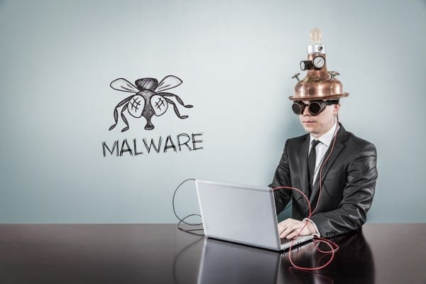 Malware concept with vintage businessman and laptop