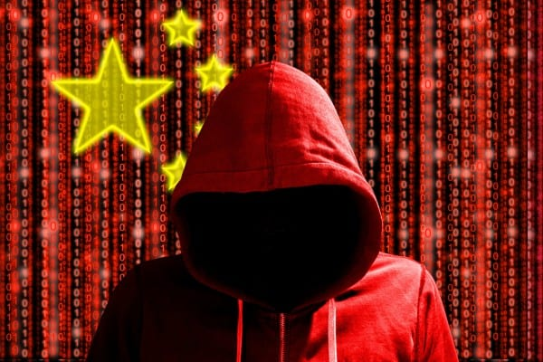 Chinese hacker in front of digital datastream flag