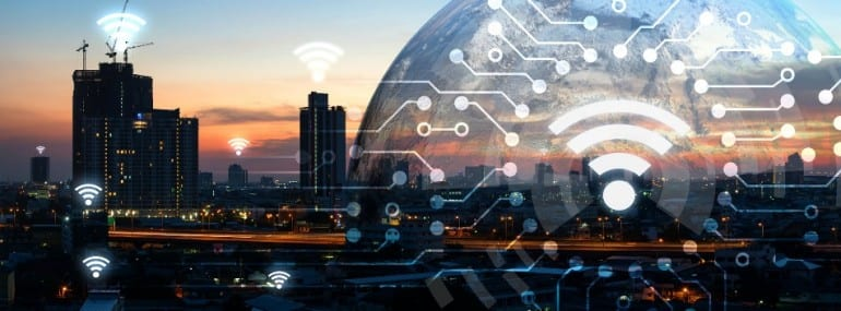 Internet of things , iot , smart home , smart city and network connect concept. Human hand holding white phone and iot icon with city sunset view and earth furnished by NASA. background and wifi icons