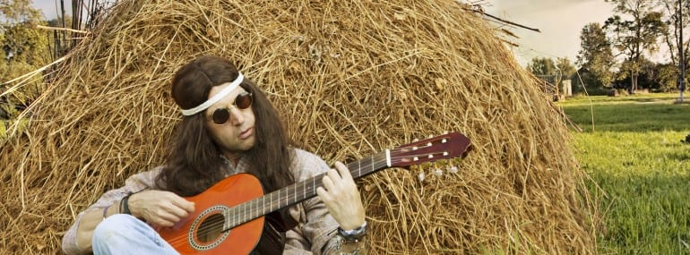 Hippie man playing guitar outdoors