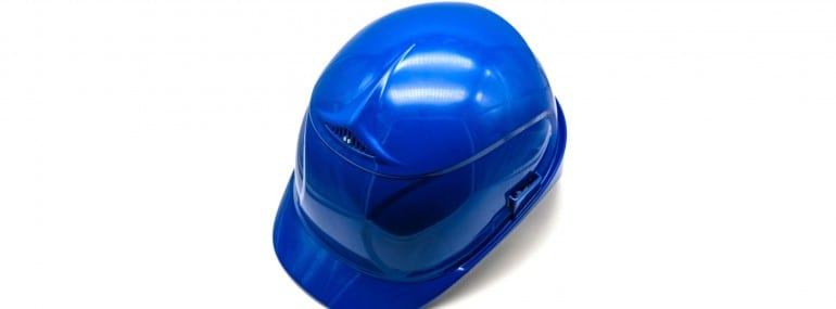 Blue construction safety helmet isolated on white background