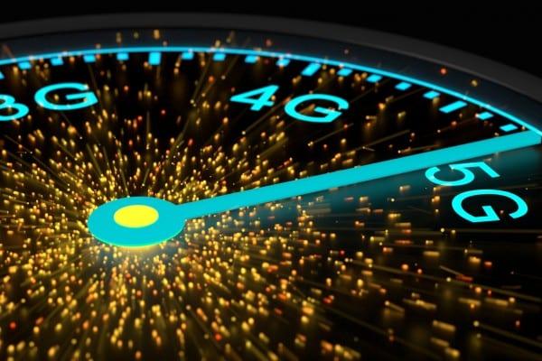 Speed instrument in blue reaching maximum 5G communication speed