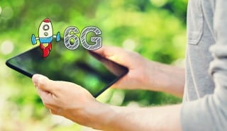 6G concept with man holding tablet