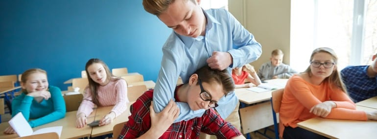 student boy suffering of classmate mockery