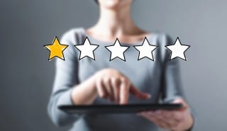 One star rating with woman using a tablet