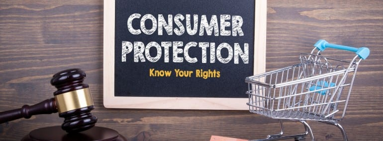 Consumer Rights Protection concept. Chalkboard on a wooden background.